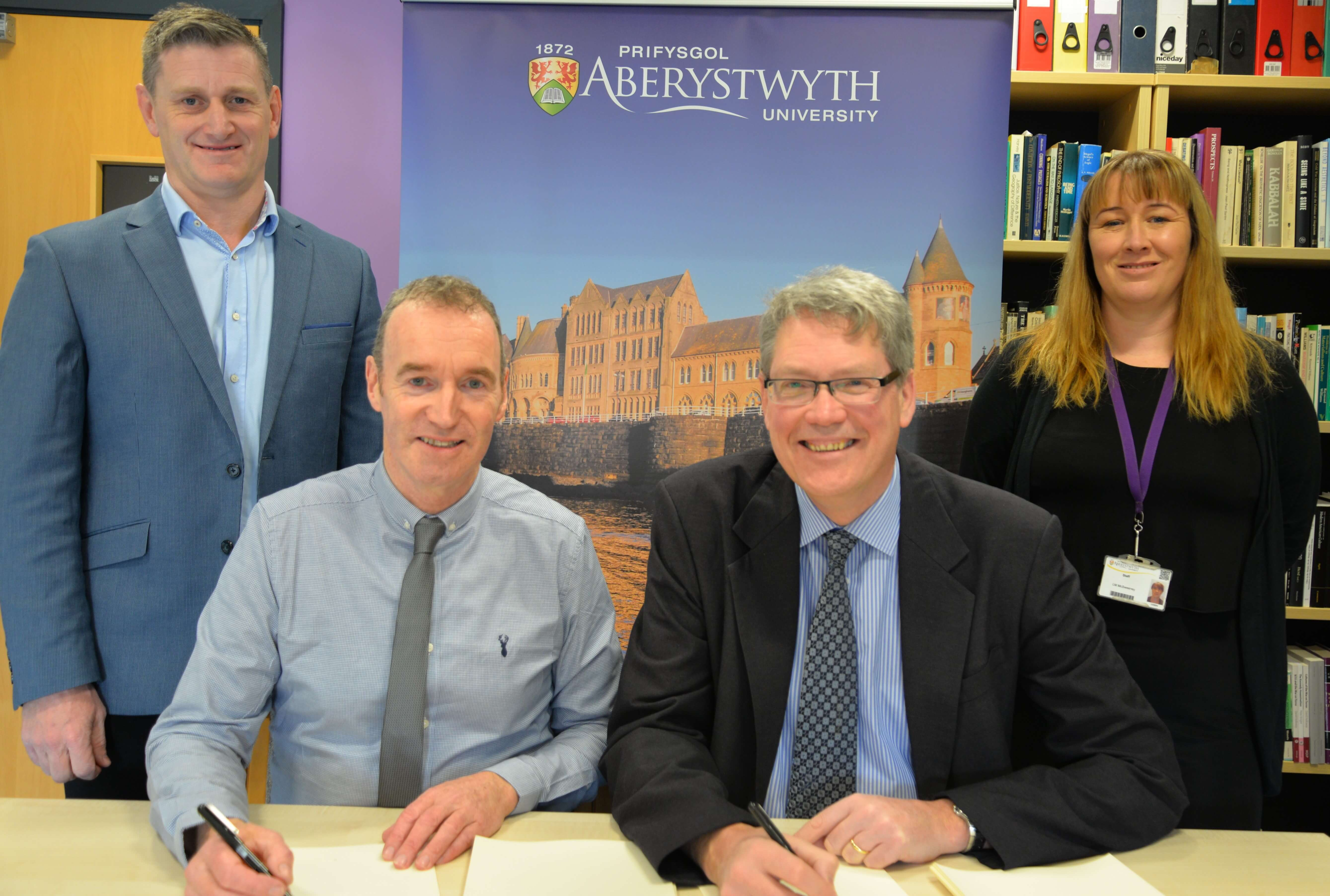 From left to right: Dr Wyn Morris, Alun Jones, Professor Tim Woods and Laura McSweeney signing the new contract