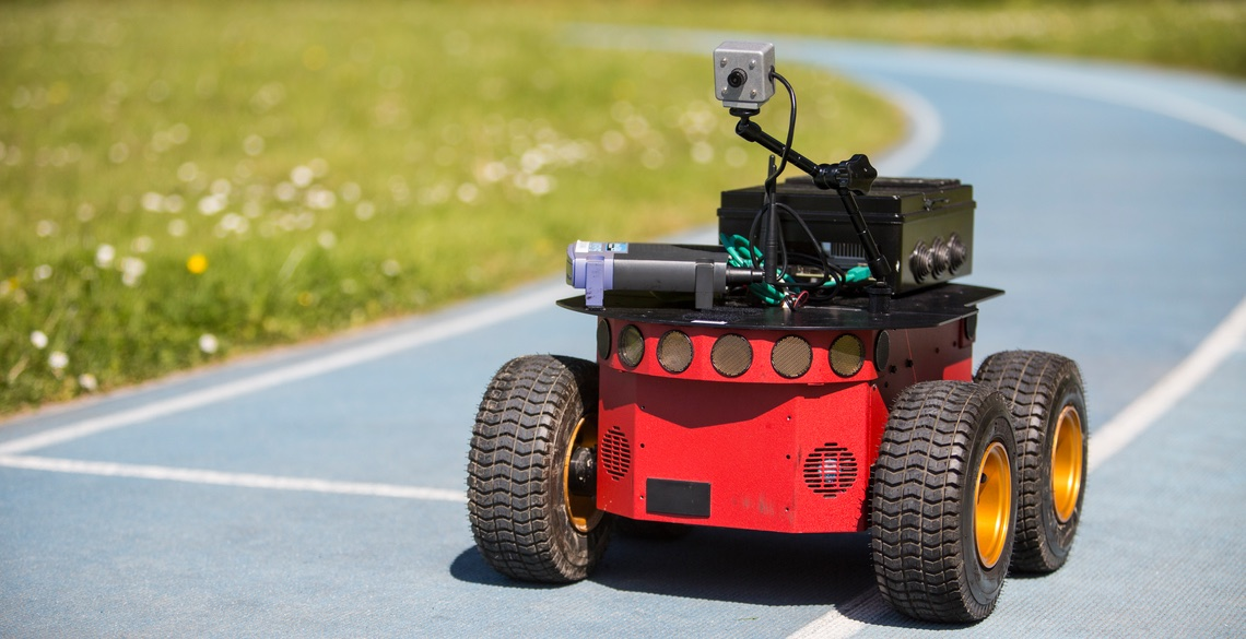 Four-wheel pioneer robot driving along a running track
