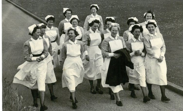Nurses from Cefn Coed Hospital walk across the grounds. Swansea Bay University Health Board Heritage Team, courtesy of Swansea Evening Post