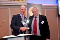 Professor Wayne Powell, IBERS Director receives the Award from David Willetts MP Minister for Universities and Science.  Copyright Andrew Davis, John Innes Centre.