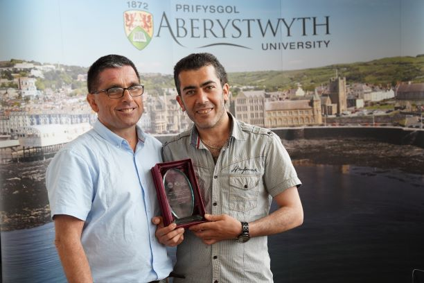 Mohammed and the Head of Learn Welsh Ceredigion, Powys and Carmarthenshire Siôn Meredith