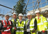 Topping out are (L to R), Paul Evans from construction company Willmott Dixon, Ryan Dixon from Architects Pascal and Watson, Professor Noel Lloyd, Vice Chancellor Aberystwyth University, Professor Wayne Powell, Director of IBERS and Jamie Lannen from project managers Davis Langdon.