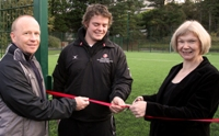 Professor April McMahon, Vice-Chancellor Aberystwyth University, opening the new 3G all weather training pitch in the company of Frank Rowe, Sports Centre Director and Alun Minifey, Student Activities Officer.
