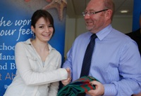 School of Management and Business student Alexandra Gencheva presents a University scarf to George Ashworth of Aldemore Bank.