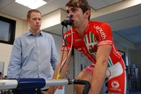 Dr Mark Burnley (left) carries out the priming warm-up technique on Gruff Lewis, who works at the University Sports Centre and is a semi-professional cyclist.