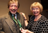 Dr David Russell Hulme receives the Glyndŵr Award from Professor April McMahon.