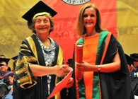 Betsan Powys being received as Fellow by the University's Vice-President, Mrs Elizabeth France CBE