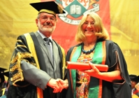 Vice President Dr Glyn Rowlands receives Dr Elaine Storkey as Fellow