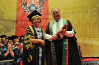 Neil Brand receiving his Fellowship from Vice-President Mrs Elizabeth France CBE