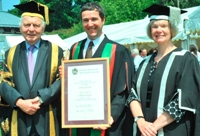 Richard Lynch (centre) with Sir Emyr Jones Parry, President of Aberystwyth University and Professor April McMahon, Vice-Chancellor