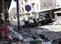 Bombed out vehicles Aleppo during the Syrian civil war. Credit: Voice of America News.