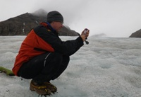Dr Arwyn Edwards, a lecturer in Biological Sciences at IBERS, collecting samples of blooming bacteria on Svalbard.
