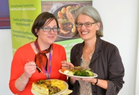 Jane Powell from Organic Centre Wales (right) and Rebecca Davies, Pro Vice-Chancellor at Aberystwyth University enjoying some of the locally sourced food provided in the University's restaurants.