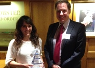 Ally Evans receives her award from Gary Reed, Director of Research, Business and Innovation at Aberystwyth University.