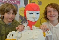 Aberystwyth Robotics Club members, Marley Plant (left) and Ferdia McKeogh, with the InMoov humanoid robot.