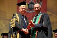 Sir Michael Moritz (right) being received as Fellow by Sir Emyr Jones Parry, President of Aberystwyth University.