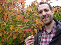 IBERS' First Year Plant Biology student Mark Morgan, with leaves - more mobile ones just don't get eaten.