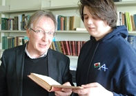 Dr Robin Chapman (left) and Robin Williams, a second year student studying Welsh and Welsh History, reading one of T Gwynn Jones' books