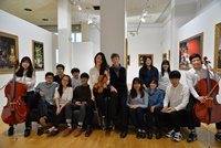 Students from the Korea Wales International Christian School who are currently studying at Aberystwyth University, with the director of the University's International English Centre, Rachael Davey.