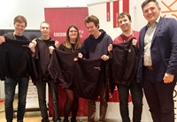 Left to right: Members of Aberystwyth University's winning team '//no Comment'; Cormac Brady, Nicholas Dart, Laura Pugh, Owen Garland and Xander Barnes receive BBC hoodies from Robin Pembrooke Head of Future Media at the BBC.