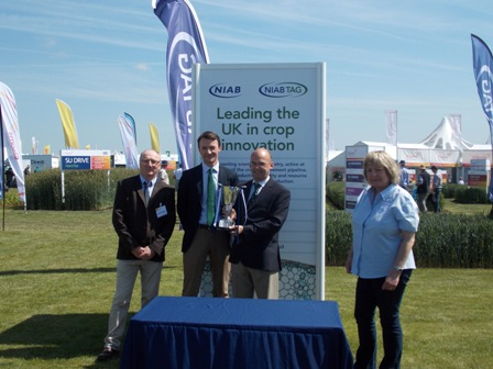 Professor Mike Gooding IBERS Director receiving the NIAB Variety Cup at CEREALS 2015, with Professor Athole Marshall IBERS, William Gilbert Germinal MD and Dr Tina Barsby,NIAB CEO