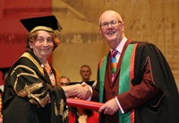 Elizabeth France, Pro Chancellor of Aberystwyth University presents an Honorary Degree to Bryn Jones