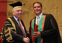 Sir Emyr Jones Parry, Chancellor of Aberystwyth University, presents Iolo Williams as Fellow