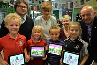 (Left to Right) Ysgol Gymraeg Aberystwyth pupils Ioan Mabbutt, Lleucu Siencyn, Cerian Williams and Modlen Gwynne celebrate the launch of the new apps in the company of Aled Morgan, Ysgol Gymraeg Aberystwyth; Lynwen Rees Jones, Director of CAA; Delyth Ifan, Editor/Projects Manager, CAA; and Dr Rhodri Llwyd Morgan, Pro Vice-Chancellor, Welsh Language and Culture, and External Engagement, Aberystwyth University.
