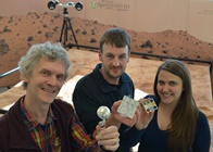 Members of Aberystwyth University's ExoMars Rover team Dr Laurence Tyler, Dr Matt Gunn and Dr Rachel Cross with items of the flight hardware developed for the 2018 mission at Aberystwyth University.