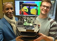 Pasi William Sachiti (left) and Ariel Ladegaard (right) with a prototype of Hugh, the robot librarian.