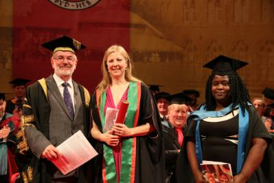 Charmian Gooch, Honorary Fellow of Aberystwyth University (centre) with Dr Glyn Rowlands, Pro-Chancellor of Aberystwyth University and Dr Engobo Emeseh, Department of Law and Criminology