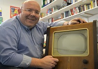 Dr Jamie Medhurst with a 1949 Philips television