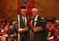 Peter Williams collecting Honorary Fellowship in memory of his brother Bill Williams, from Aberystwyth University Treasurer Dr Timothy Brain OBE