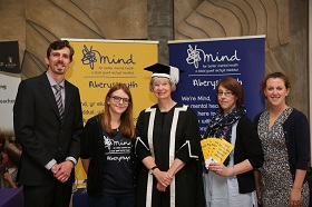 Vice Chancellor of Aberystwyth University, Professor April McMahon (centre) with MIND Aberystwyth staff, left to right: Tim Bennett, Eleanor Parker, Jennie Thomas and Bethan Roberts