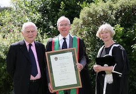 Chancellor Sir Emyr Jones Parry, Sir Evan Paul Silk KCB and Vice-Chancellor Professor April McMahon