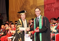 Aled Haydn Jones receiving Honorary Bachelor of Arts Degree from Pro-Chancellor, Mrs Elizabeth France CBE
