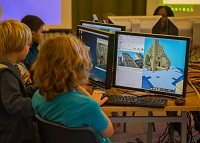 Participants learning how to code in Minecraft and 'build' parts of the Old College