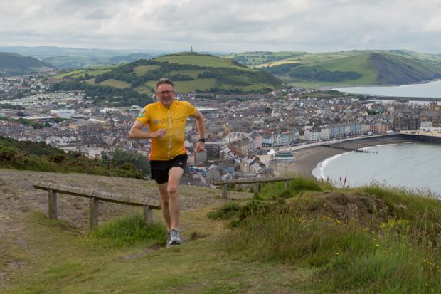 Professor John Grattan during one of his training runs up Constitution Hill in Aberystwyth.