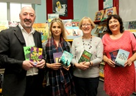 Left to right: Elwyn Jones, Chief Executive of the Welsh Books Council, Jenna Hughes and Joanna Jeffery from Aberystwyth University, and Eirlys Wyn Parry from the Welsh Books Council's Department of Children's Books, with a selection of the books eligible for a Tir na n'Og award.