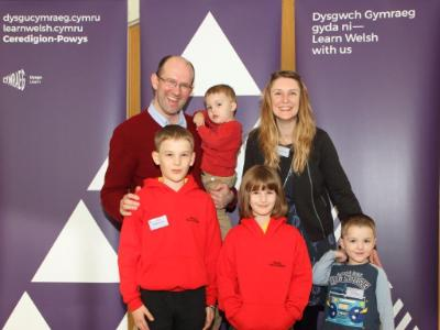 Winners of the Welsh in the Family Award - Vicky Thomas with her husband Huw and their four children.