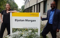 Emma Williams and Dr Ola Olusanya outside the Elystan Morgan building, Aberystwyth Law School