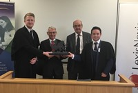 L to R: Jake Moses, HHJ Milwyn Jarman QC, HHJ John Diehl QC and Jake Woodcock with the LexisNexis Welsh National Moot Trophy in the Aberystwyth Law School Moot Court