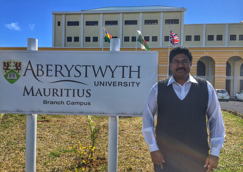 Dr Dinesh Chuckravanen outside Aberystwyth University Mauritius campus