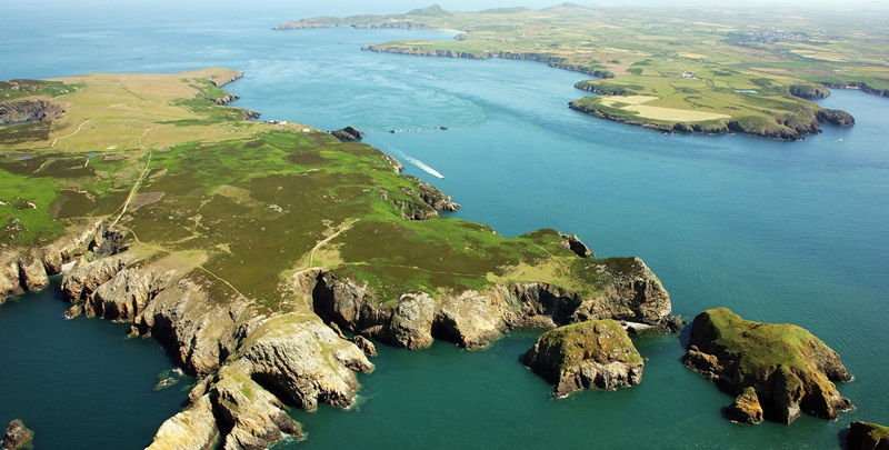 An aerial view of Ramsey island and the north Pembrokeshire coastline. Crown Copyright: The Royal Commission on the Ancient and Historical Monuments of Wales