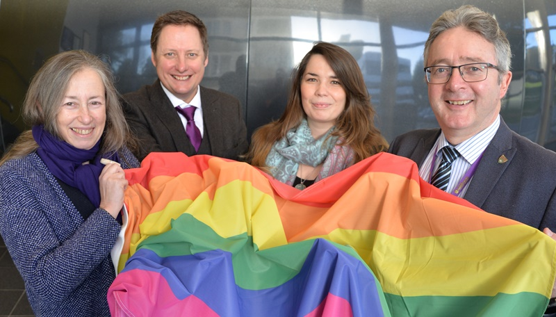 Celebrating Aberystwyth University's rise in the Stonewall Workplace Equality Index are (left to right) Debra Croft, Director of Equality, Gary Reed, Director - Research, Business & Innovation, Ruth Fowler Communications and Equalities Officer and Professor John Grattan, Acting Vice-Chancellor.