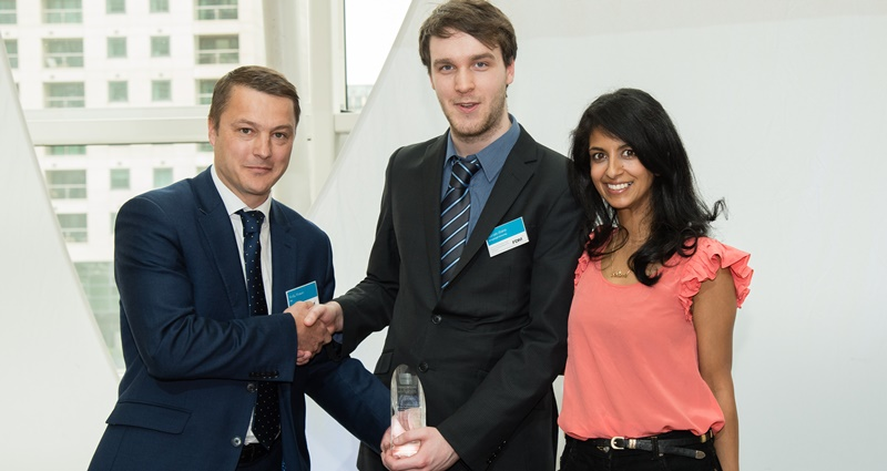 Kieran Stone (centre) receives his award from sponsor Andy Brown of FDM Group and writer and television presenter Konnie Huq.