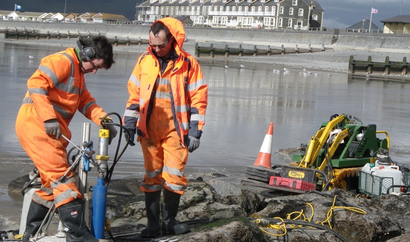Drill-coring artificial rock pools at Tywyn. Led by Aberystwyth University, Ecostructure will boost biodiversity on coastal structures in Wales and Ireland by enhancing the ecological value of coastal defence and renewable energy structures in Wales and Ireland.