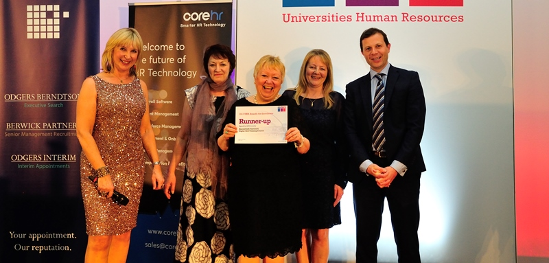 Lesley Spees (centre) and Sue Chambers (second from left) from Aberystwyth University's Human Resources team receive recognition for the good work done on digital skills training at the annual UK Universities Human Resources (UHR) Awards.