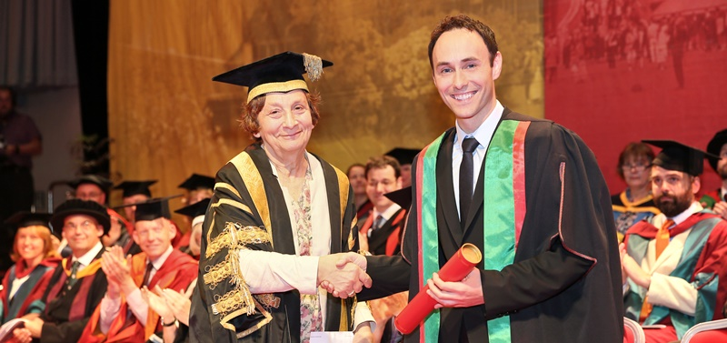 Aled Haydn Jones being presented with an Honorary Bachelor of Arts Degree from Deputy Chancellor Elizabeth France.