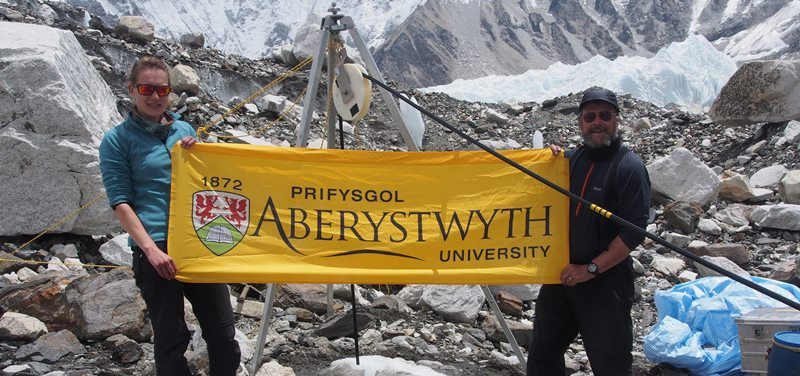 Aberystwyth University members of the EverDrill project, Katie Miles and Professor Bryn Hubbard, flying the Aber flag at drill site 3 on the Khumbu glacier near Everest Base Camp.